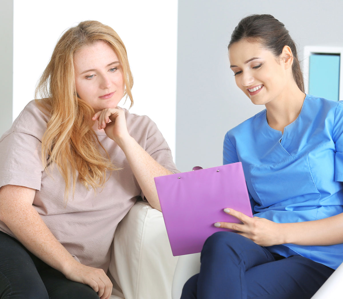 Nurse consulting with caucasian young woman